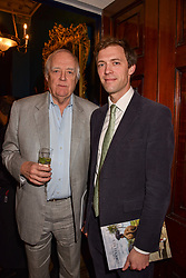 Sir Tim Rice and his son Donald Rice at Mark Shand's Adventures and His Cabinet Of Curiosities VIP private view, 32 Portland Place, London, England. 20 February 2018.
