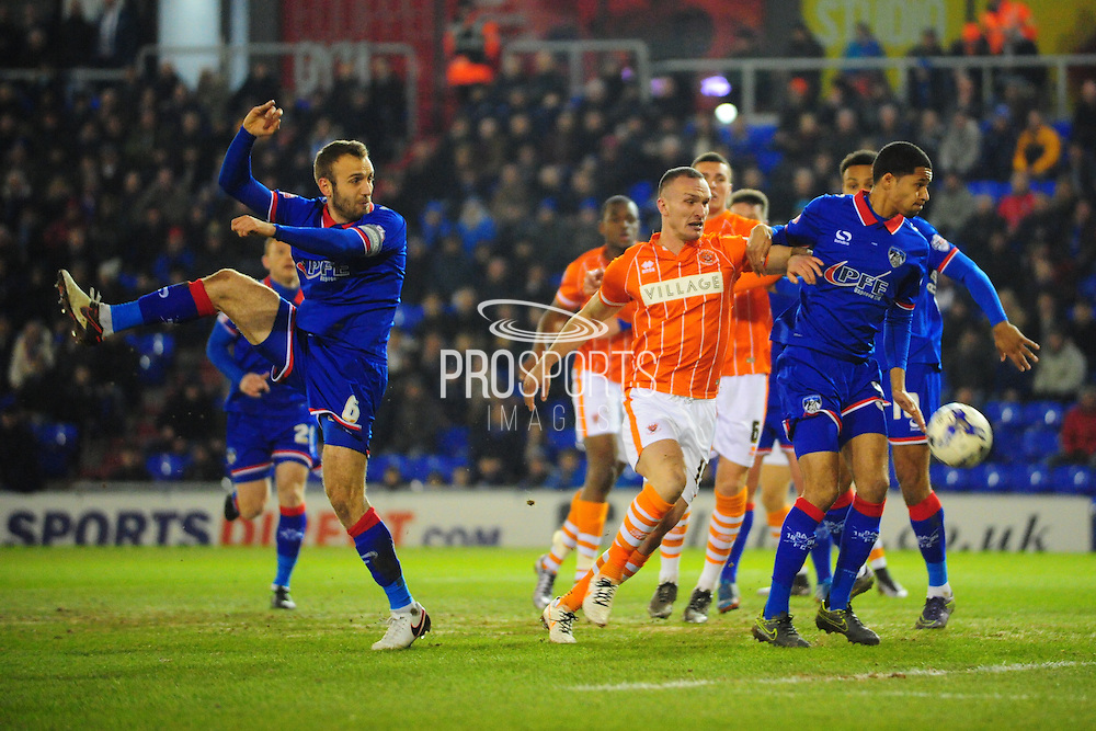 Tom Aldred of Blackpool FC goes close after Liam Kelly of Oldham Athletic mistimes his clearance during the Sky Bet League 1 match between Oldham Athletic and Blackpool at SportsDirect.Com Park, Oldham, England on 15 March 2016. Photo by Mike Sheridan.