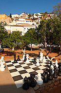 Chess board in the central park of Hydra, Greek Cyclades Islands .<br /> <br /> Visit our GREEK HISTORIC PLACES PHOTO COLLECTIONS for more photos to download or buy as wall art prints https://funkystock.photoshelter.com/gallery-collection/Pictures-Images-of-Greece-Photos-of-Greek-Historic-Landmark-Sites/C0000w6e8OkknEb8