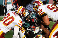 LANDOVER, MD - NOVEMBER 11: Runingback Brian Westbrook of the Philadelphia Eagles is taken down during the game against the Washington Redskins on November 11, 2007 at FedEx Field in Landover, Maryland. The Eagles won 33-25.