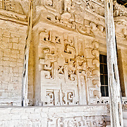 """Ornate carvings on the exterior of the Tomb of Ukit Kan Le'k Tok' at the ancient Mayan ruins at Ek'Balam, near Valladolid, Yucatan, Mexico. The jaguar is a recurring motif, as evidenced by the large stone teeth, etc. Ek' Balam means """"dark jaguar."""""""