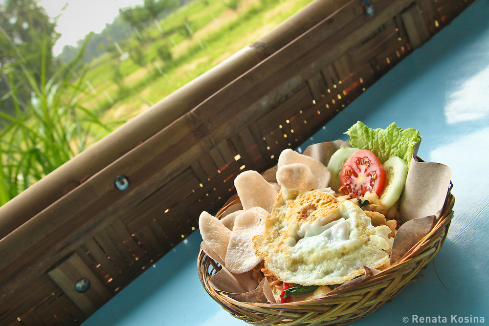 Balinese lunch served in a roadside bamboo hut - delicious Mie Goreng - Indonesian fried noodles.