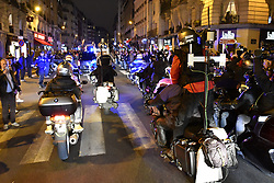 Press motorcycles are following the car of newly elected French President Emmanuel Macron on his way to the Louvre Pyramid to deliver his speech in front of his supporters after the second round of the presidential elections in Paris, France on May 7, 2017. Macron, a 39-year-old pro-business centrist, defeated Marine Le Pen, a far-right nationalist who called for France to exit the European Union, by a margin of 65.5 % to 34.1%, becoming the youngest president in France's history. Photo by Pascal RondeauABACAPRESS.COM