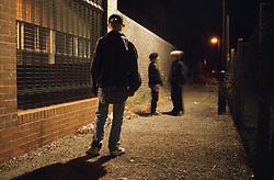 Group of children standing in alley way,