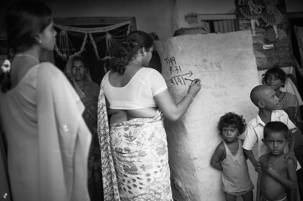 House marking during vaccination day at a village on the flood plains of the Kosi river near Kusheshwar Asthan (E), Bihar.