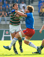 Photo: Henry Browne.<br /> Stade Francais v Leicester Tigers. Heineken Cup.<br /> 29/10/2005.<br /> Daryl Gibson of Tigers is stopped by Stade's Shaun Sowerby.