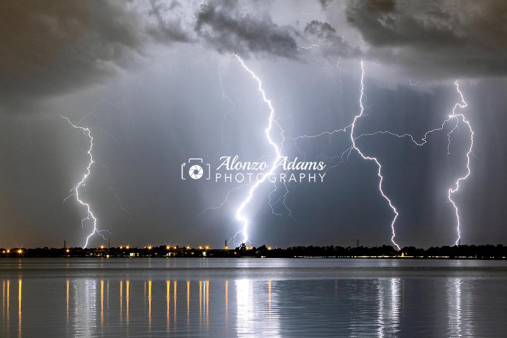 Lightning near Lake Overholser in Yukon and Oklahoma City on Sunday, Oct. 20, 2019. Photo copyright © 2019 Alonzo J. Adams.
