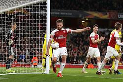 Arsenal's Shkodran Mustafi (left) celebrates his side's second goal