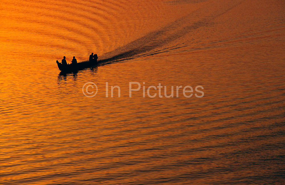 A boat on the River Euphrates in Basra at sunset, Iraq