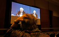 A Berkshire Hathaway shareholder in an overflow room watches the Berkshire Hathaway annual meeting on a TV screen in Omaha, Nebraska, U.S. May 6, 2017. REUTERS/Rick Wilking