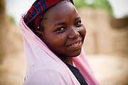 A woman poses for a portrait after getting vaccinated against meningitis at a MSF vaccination site in Tibiri, Niger on Friday April 17, 2009.