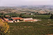 Remelluri Winery: Granja Nuestra Senora de Remelluri, S.A. in Labastida, Rioja, Spain. In the background (R) is the picturesque hilltop town of San Vincente de la Sonsierra in La Rioja Alta.