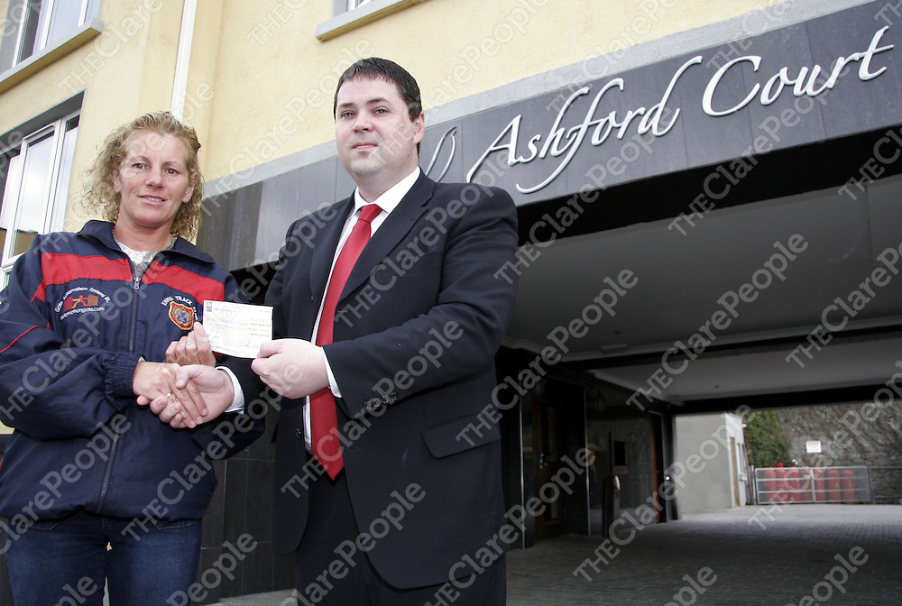 Marian O'Loughlin - trainer Ennis Track Club accepts a cheque for ?400 from Liam Heffernan - manager of the Ashford Court Hotel Ennis in aid of the Ennis Track Club Training Fund.<br /> <br /> Photograph by Yvonne Vaughan.