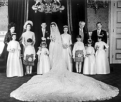 Princess Alexandra and her bridegroom Angus Ogilvy pose with members of their family during the reception at St. James's Palace in London after their wedding ceremony at Westminster Abbey.