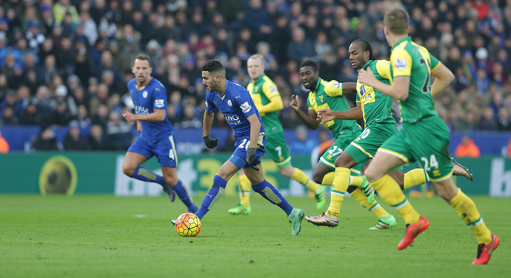 Leicester City's Riyad Mahrez pursued by the Norwich City defence<br /> <br /> Photographer Stephen White/CameraSport<br /> <br /> Football - Barclays Premiership - Leicester City v Norwich City - Saturday 27th February 2016 - King Power Stadium - Leicester<br /> <br /> © CameraSport - 43 Linden Ave. Countesthorpe. Leicester. England. LE8 5PG - Tel: +44 (0) 116 277 4147 - admin@camerasport.com - www.camerasport.com