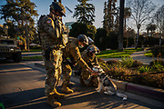Members of the National Guard pet a husky puppy in Capitol Park on Inauguration Day on Jan. 20, 2021.