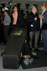 Wouldn't be caught dead wearing that? How about Undead?..Beginning with a drinks and Canapési reception complete with coffin, candles and gravestones the undead can walk the streets of Sheffield in style after Last nights (Thursday 6th October)Vampire Fashion Show, the launch event for the start of Sheffield Fashion Week,  held on the 4th floor of a (Q-Parks) Multi-Storey Car park..6th October 2011..Image © Paul David Drabble