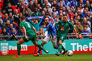 Chertsey Town's Dale Binns (11) beats Cray Valley's Danny Smith (3) and Cray Valley's Liam Hickey (4) during the FA Vase final match between Chertsey Town and Cray Valley at Wembley Stadium, London, England on 19 May 2019.