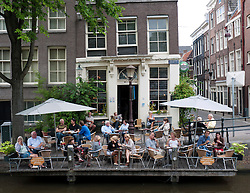 Cafe beside canal in Jordaan district of Amsterdam The Netherlands