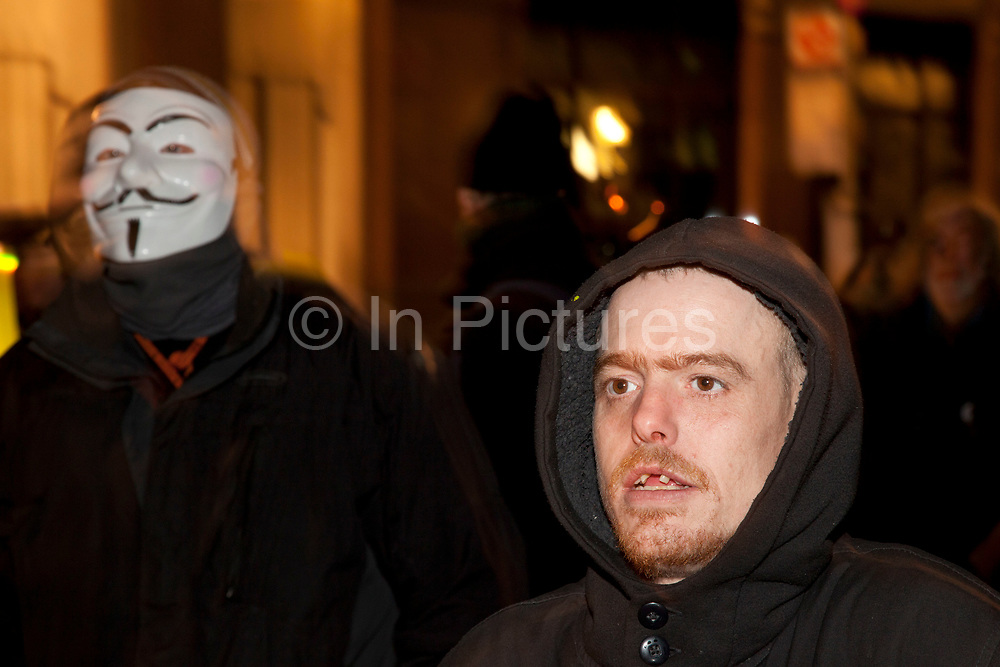 Masked protester as eviction of the Occupy London OLSX camp takes place. The anti-capitalist demonstration that saw protesters camp outside St Paul's Cathedral in London was brought to an end by bailiffs and police. Protesters staging Occupy London were refused permission by the Court of Appeal last week to challenge orders evicting them from the cathedral steps, where they had been living in tents since October 15 last year. The City of London Corporation called on protesters to remove their tents voluntarily, but around 50 or 60 refused to budge. Some protesters created makeshift barriers out of wooden shelving units as police moved in to help bailiffs clear the camp. Police said 20 people had been arrested but the operation was largely peaceful.