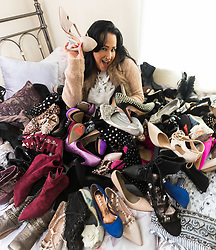 East Grinstead, October 03 2017. Musician and music promoter Natalie West with just some of her collection of over 500 pairs of shoes. © Paul Davey