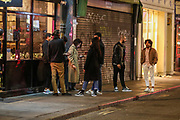 "A group of youngsters enjoy a late after mid-night walkout in Soho, London West End on early Monday, Sept 14, 2020. The public has been urged to act ""in tune"" with Covid-19 guidelines as the ""rule of six"" restrictions is into force on Monday. The British government's scientific advisory board announced on Friday that the reproduction number of coronavirus transmission across the UK was now over 1.0. The Science and the Scientific Advisory Group for Emergencies (SAGE) said the R-value was now between 1.0 and 1.2. (VXP Photo/ Vudi Xhymshiti)"