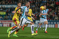 Jonson Clarke-Harris (Rotherham United) tries to get to the ball in front of the goal and Joel Lynch (Huddersfield Town) guides it out during the Sky Bet Championship match between Huddersfield Town and Rotherham United at the John Smiths Stadium, Huddersfield, England on 15 December 2015. Photo by Mark P Doherty.