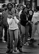 Family and friends of the victim of a Chicago police-involved shooting confront officers at the scene Saturday, Dec. 15, 2012 at 1600 W Garfield.