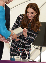 The Duchess of Cambridge after signing a photo for a time caspsule as she visits the National Graphene Research Institute during a day of engagements in Manchester.