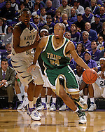 William & Mary guard Adam Payton (24) drives the baseline past Kansas State guard Akeem Wright (34) in the first half at Bramlage Coliseum in Manhattan, Kansas, November 11, 2006.  K-State defeated the Tribe 70-60.<br />