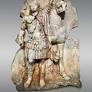 Roman Sebasteion relief sculpture of  an Imperial prince as Diokouros son of zeus, Aphrodisias Museum, Aphrodisias, Turkey. <br /> <br /> An imperial youth wearing a military cloak and cuirass of a commander holds the reins of hios horse. This panel is next to a Claudius panel so is probably of Britanicus or Nero the emperors son and intended successor