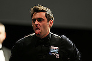 Ronnie O'Sullivan reacts during his match against Mark Selby.  Betvictor Welsh Open snooker 2016, day 5 at the Motorpoint Arena in Cardiff, South Wales on Friday 19th Feb 2016.  <br /> pic by Andrew Orchard, Andrew Orchard sports photography.