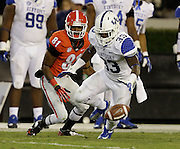 ATHENS, GA - NOVEMBER 23:  Return man Reggie Davis #81 of the Georgia Bulldogs and Dyshawn Mobley #33 of the Kentucky Wildcats pursue the ball after Davis' fumble during the game at Sanford Stadium on November 23, 2013 in Athens, Georgia.  (Photo by Mike Zarrilli/Getty Images)