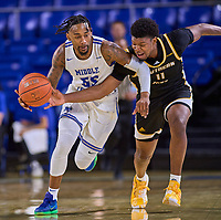 Southern Miss Golden Eagles guard LaDavius Draine (11) tries to steal the ball from Middle Tennessee Blue Raiders guard Antonio Green (55) during the Southern Mississippi Golden Eagles at Middle Tennessee Blue Raiders college basketball game in Murfreesboro, Tennessee, Saturday, March, 7, 2020.<br /> Photo: Harrison McClary/All Tenn Sports