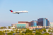 Delta Airlines Flying Over Executive Park In Irvine