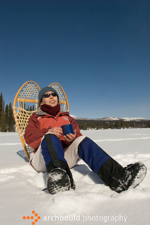 Woman takes a break from snowshoeing, Yukon<br /> <br /> NOT IN YOUR BUDGET? Contact Cathie for a price specific to your project.