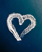 Aerial view above of speed boats drawing heart shape at Adriatic sea, Croatia.