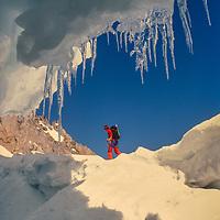 Bela Vadasz skis beside the bergschrund crevasse on the U-Notch couloir on  the Palisade Glacier, Sierra Nevada, CA