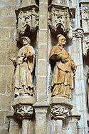 Statues of The Gothic Puerta de Campanilla entrance door of the Cathedral of Seville, Spain . The Royal Alcázars of Seville (al-Qasr al-Muriq ) or Alcázar of Seville, is a royal palace in Seville, Spain. It was built by Castilian Christians on the site of an Abbadid Muslim alcazar, or residential fortress.The fortress was destroyed after the Christian conquest of Seville The palace is a preeminent example of Mudéjar architecture in the Iberian Peninsula but features Gothic, Renaissance and Romanesque design elements from previous stages of construction. The upper storeys of the Alcázar are still occupied by the royal family when they are in Seville. <br /> <br /> Visit our SPAIN HISTORIC PLACES PHOTO COLLECTIONS for more photos to download or buy as wall art prints https://funkystock.photoshelter.com/gallery-collection/Pictures-Images-of-Spain-Spanish-Historical-Archaeology-Sites-Museum-Antiquities/C0000EUVhLC3Nbgw <br /> .<br /> Visit our MEDIEVAL PHOTO COLLECTIONS for more   photos  to download or buy as prints https://funkystock.photoshelter.com/gallery-collection/Medieval-Middle-Ages-Historic-Places-Arcaeological-Sites-Pictures-Images-of/C0000B5ZA54_WD0s