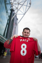 © Licensed to London News Pictures . 27/01/2014 . Manchester , UK . KYLE GOLDSWORTHY (26) from Bristol poses with his new shirt in front of Old Trafford . He is in Manchester for the Cardiff match tomorrow . Fans with new MATA 8 shirts in front of Old Trafford Football Ground as it's announced that Spaniard Juan Mata ( Juan Manuel Mata García ) has signed for Manchester United  . Photo credit : Joel Goodman/LNP