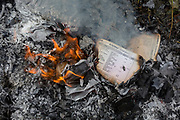 The burning on a bonfire of confidential personal data, accounts records and general paperwork, on 30th July 2017, in Wrington, North Somerset, England.