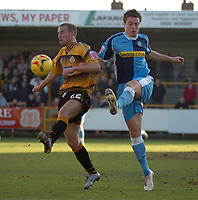Photo: Ian Hebden.<br />Boston United v Wycombe Wanderers. Coca Cola League 2. 18/02/2006.<br />Boston's Peter Till (L) and Wycombe's Russell Martin (R) contest the ball.