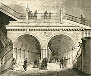 'Portal of the Thames Tunnel linking Rotherhithe and Wapping.  Begun in 1825 by Marc Isambard Brunel, it is now part of the London Underground Railway system. Engraving c1880.'