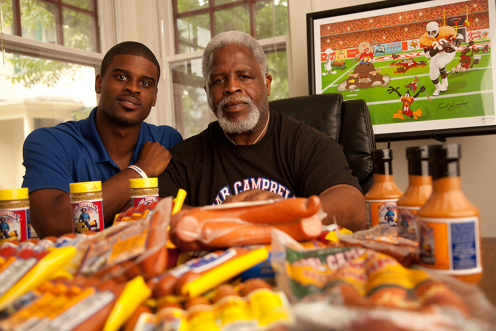 AUSTIN, TX - MAY 14: Earl Campbell and his son Tyler Campbell pose for a portrait in Austin, Texas on May 14, 2012. © 2012 Darren Carroll