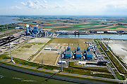 Nederland, Groningen, Eemshaven, 05-08-2014; Haven omzoomd door windmolens. Energie-landschap met elektricitieitscentrales van Nuon (voorgrond) en de RWE-Essent elektriciteitscentrale (midden, kolencentrale) .<br /> Harbor area and energy landscape with wind turbines and different power plants:<br /> Nuon (Magnum multi-fuel plant (foreground) and the coal fired  RWE-Essent plant (middle).<br /> <br /> luchtfoto (toeslag op standard tarieven);<br /> aerial photo (additional fee required);<br /> copyright foto/photo Siebe Swart