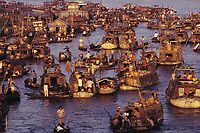 """The Floating Market at Cai Rang, near Can Tho, in the Mekong Delta, Vietnam, ca. 1991<br /> Available as Fine Art Print in the following sizes:<br /> 08""""x12""""US$   100.00<br /> 10""""x15""""US$ 150.00<br /> 12""""x18""""US$ 200.00<br /> 16""""x24""""US$ 300.00<br /> 20""""x30""""US$ 500.00"""