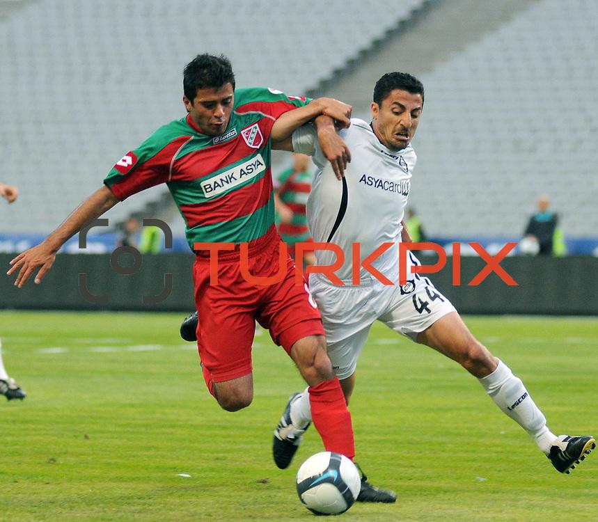 Karsiyakaspor's Ayhan EVREN (L) and Altayspor's Mehmet BUDAK (R) during their Play Off First leg match at Ataturk olympic Stadium in Istanbul Turkey on Monday, 17 May 2010. Photo by TURKPIX