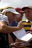 Photo. Richard Lane.<br />DFS Classic Tennis at Edgebaston. 09/06/2003.<br />Anna Kournikova signs autographs.