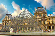 The Pyramid entrance of the Louvre - Paris .<br /> <br /> Visit our FRANCE HISTORIC PLACES PHOTO COLLECTIONS for more photos to download or buy as wall art prints https://funkystock.photoshelter.com/gallery-collection/Pictures-Images-of-France-Photos-of-French-Historic-Landmark-Sites/C0000pDRcOaIqj8E