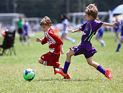 26th April, 2015. Pensacola, Florida.<br /> Gulf Coast Invitational. 6 v 6.<br /> Champions. U9 New Orleans Jesters Elites, Green team (1) v FC Dallas in the finals. Jesters emerge victorious with an 3-1 win. <br /> Photo; Charlie Varley/varleypix.com